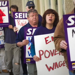 Members of the Maine State Employees Association, SEIU Local 1989, and the Maine AFL-CIO demonstrate outside the Holiday Inn by the Bay in Portland when U.S. House Speaker John Boehner was inside last year. Protesters called for raising the federal minimum wage. Groups in Maine have started an effort to raise the minimum wage statewide.