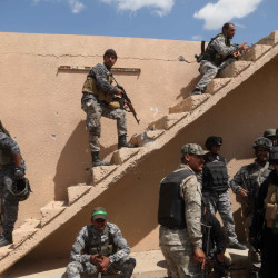 Iraqi security forces and allied Shiite militiamen gather before an attack on Islamic State extremists in Tikrit, Iraq, on Tuesday. A claim by Iraq that Tikrit has been retaken signifies a major victory for government forces.