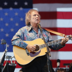 "Singer/songwriter Don McLean, shown performing at a Fourth of July celebration in Portland, is auctioning off the manuscript with the lyrics to his enigmatic hit ""American Pie."""