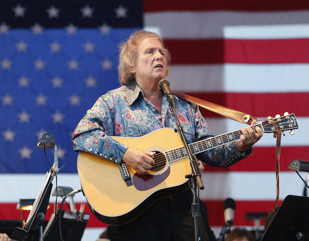 """Singer/songwriter Don McLean, shown performing at a Fourth of July celebration in Portland, is auctioning off the manuscript with the lyrics to his enigmatic hit """"American Pie."""""""