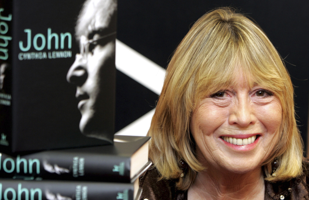 "Cynthia Lennon, the first wife of Beatle John Lennon, is shown with her book ""John"" in 2005. She described her life with Lennon as ""an undercover existence."""