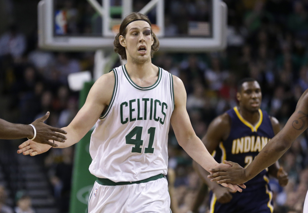 Celtics center Kelly Olynyk gets congrats from teammates during the fourth quarter Wednesday night. He scored 19 points against the Indiana Pacers, after looking like he would miss the game because of an eye injury.