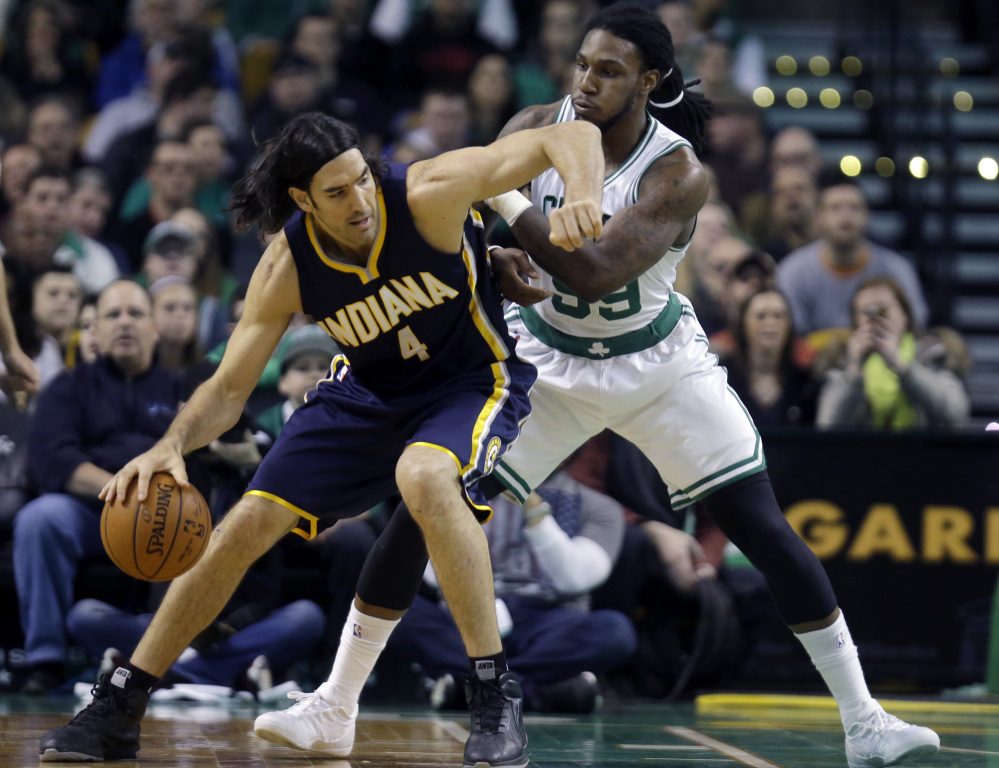 Indiana Pacers forward Luis Scola makes a move against Celtics forward Jae Crowder during the first half of Wednesday night's game in Boston. Crowder started and finished a fourth-quarter rally for the Celtics.