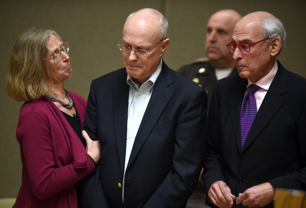 Robert Dellinger is flanked by his attorneys while his sentence of nine to 20 years is read by the judge in Grafton Superior Court in North Haverhill, N.H., Thursday.
