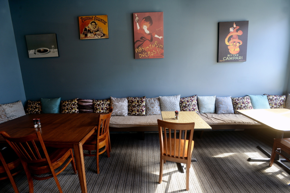 The dining room is a hodge-podge of mismatched tables and eclectic art.