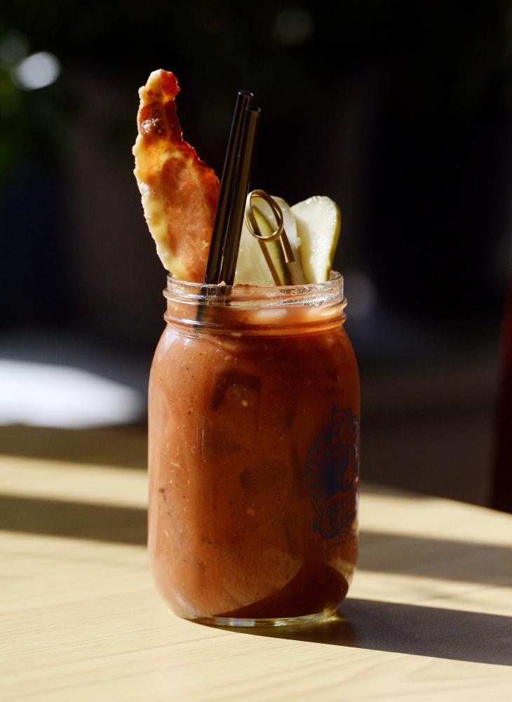 A bloody Mary with bacon and pickle.
