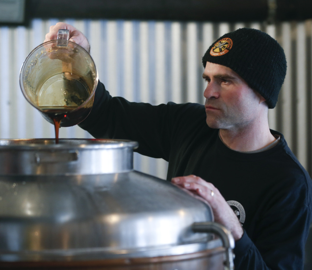 Brewer Matthew Perry adds maple syrup to beer being made at Chatham Brewing in Chatham, N.Y. Perry says the maple syrup works better with a malty beer than a hoppy one.