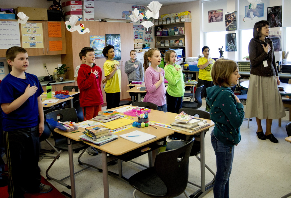 With hands over hearts, the way it's been since 1942, fourth-graders in Robin Reinhold's homeroom at South Portland's Brown Elementary School start the day with the Pledge of Allegiance.