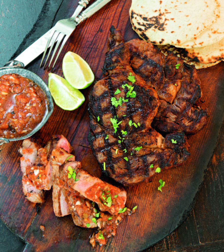 "Shannon Bard's red chile-marinated rib eye steaks, one of more than 100 recipes in ""The Gourmet Mexican Kitchen."""