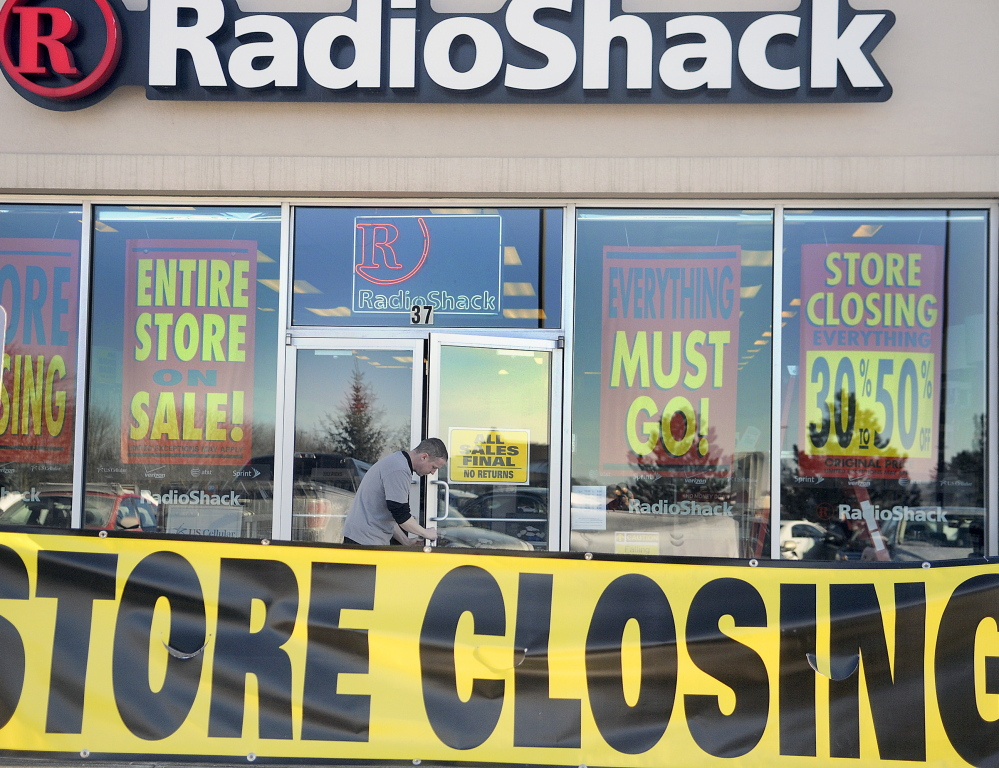 Charles Weymouth unlocks the RadioShack store at the MarketPlace in Augusta in February. A new ownership group is trying to breathe new life into the electronics chain. 2011 Kennebec Journal file photo/Andy Molloy