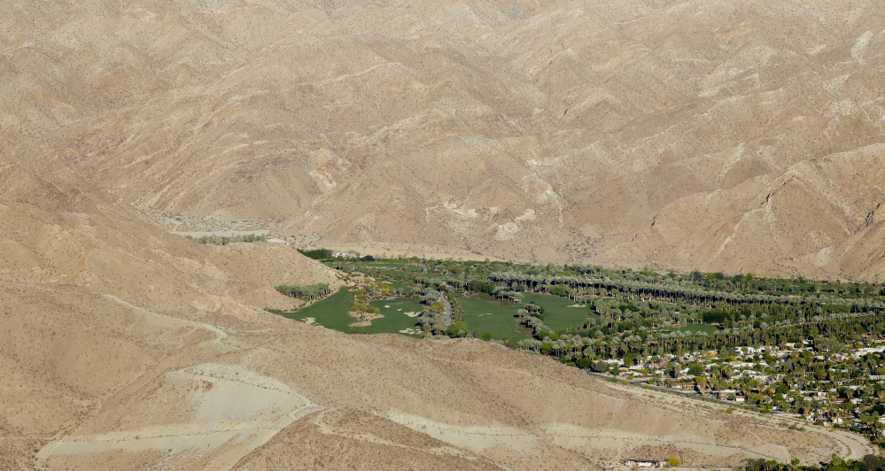 This aerial photo shows the Porcupine Creek Golf Club bordering the desert in Rancho Mirage, Calif. California Gov. California cities face mandatory targets to slash water use as much as 35 percent while regulators warn voluntary conservation hasn't been enough in the face of a devastating drought.