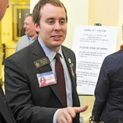 AUGUSTA, ME - APR. 8: Sen. Eric Brakey, R-Auburn, talks to people on the fourth floor before a Criminal Justice and Public Safety committee hearing on several gun bills on Wednesday April 8, 2015 at the State House in Augusta.