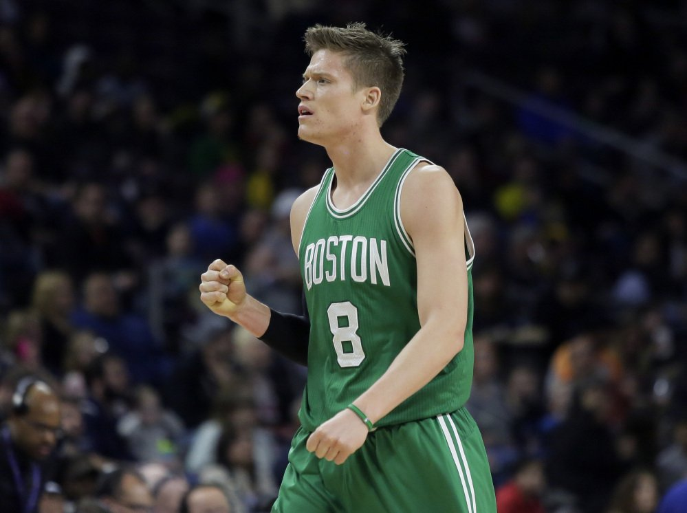 The Celtics' Jonas Jerebko, who was traded to Boston from the Pistons this season, pumps a fist after feeding teammate Isaiah Thomas for a three-point basket to end the first quarter Wednesday night in Auburn Hills, Mich.