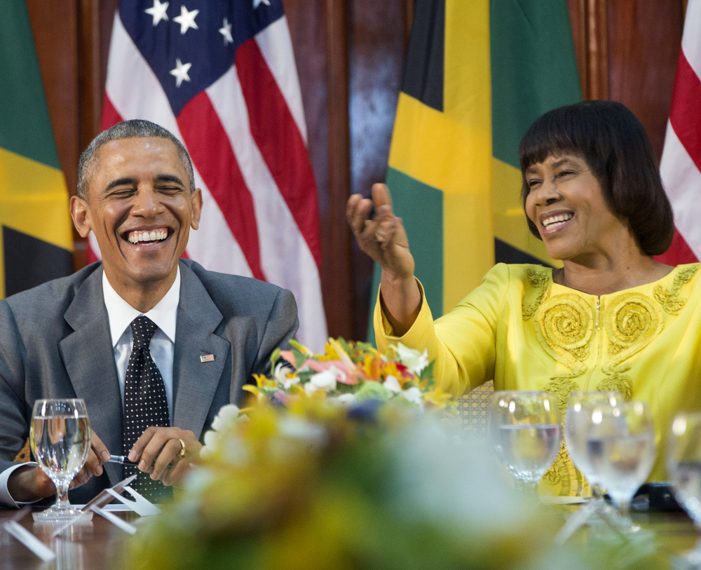 """President Obama, left, shown with Jamaican Prime Minister Portia Simpson-Miller, in Kingston, Jamaica, said, """"We don't want to be imprisoned by the past"""" regarding Cuba."""