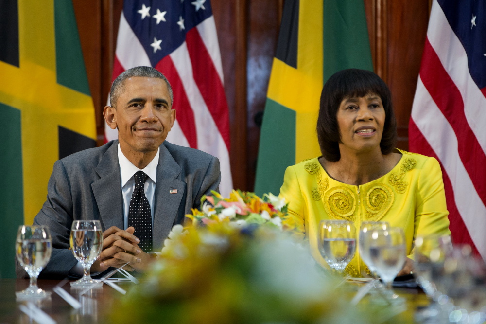 President Obama, left, and Jamaican Prime Minister Portia Simpson-Miller meet at the Jamaica House on Thursday, in Kingston, Jamaica. The president said Thursday that he will soon decide whether to remove Cuba from the U.S. list of state sponsors of terrorism now that the State Department has finished a review on the question as part of the move to reopen diplomatic relations with the island nation.