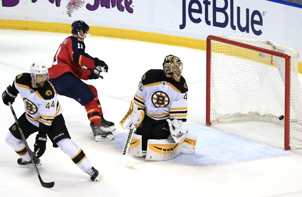 Bruins goalie Tuukka Rask gives up a goal to Florida Panthers center Aleksander Barkov (not pictured) as center Jonathan Huberdeau skates past defenseman Dennis Seidenberg in the second period Thursday night in Sunrise, Fla. The Bruins suffered a costly 4-2 defeat.