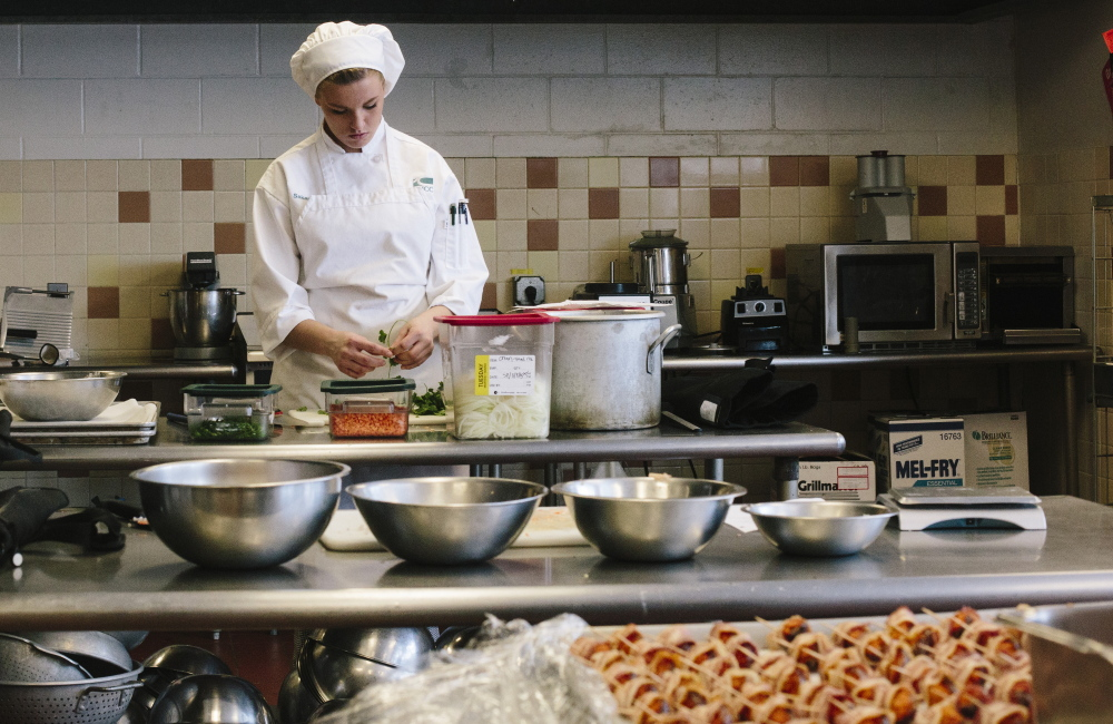 Sakara Poppas prepares ingredients for a fried rice dish in Southern Maine Community College's culinary arts lab. In recent years, the school has added programs in computer forensics, network security and precision machining, among other things.