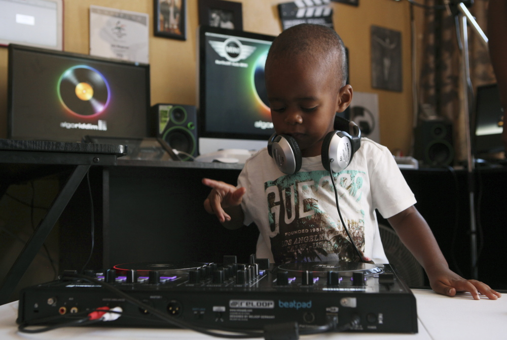 Known to 25,000 Facebook fans as DJ AJ,  2-year-old Oratilwe Hlongwane, manipulates the buttons and knobs of a sophisticated music system.