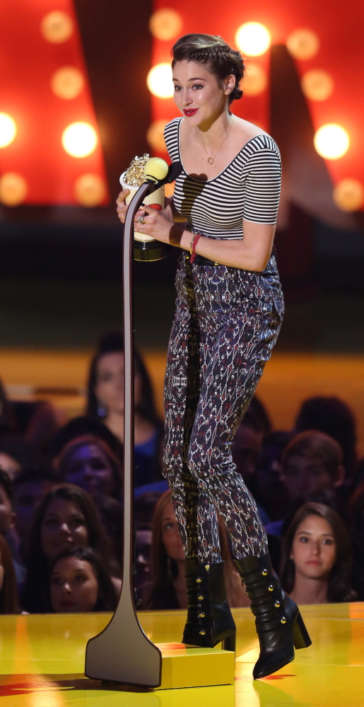 Shailene Woodley accepts the best female performance award Sunday at the MTV Movie Awards in Los Angeles.