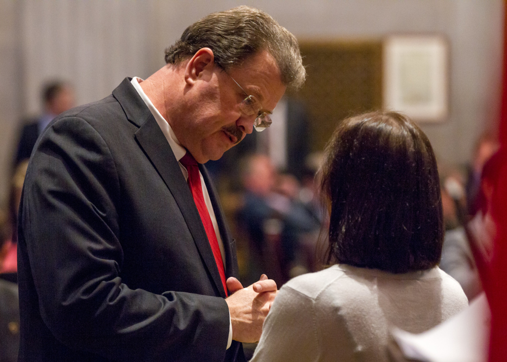 Tennessee Rep. Jerry Sexton, R-Bean Station, speaks with a colleague on the House floor in Nashville on Wednesday.