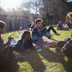 Students smoke cigarettes in New York's Washington Square Park. A new government report finds traditional cigarettes are losing popularity as more kids try e-cigarettes.