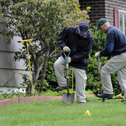 Law enforcement agents dig in the front yard of the home of Robert Gentile in Manchester, Conn., on May 10, 2012. The reputed Connecticut mobster is allegedly linked to artwork stolen from Boston's Isabella Stewart Gardner Museum in 1990.