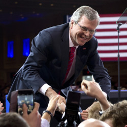Former Florida Gov. Jeb Bush shakes hands with the audience after speaking at the Conservative Political Action Conference in National Harbor, Md., on Feb. 27. Bush has not yet announced his candidacy for president, but is raising significant sums of money.