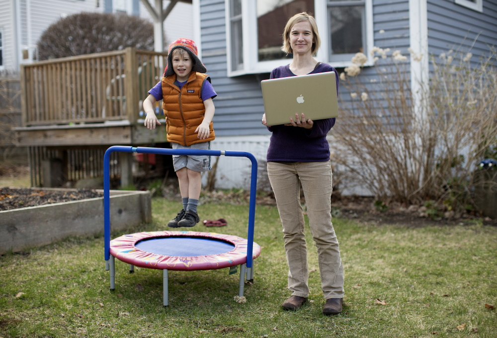 Misty McLaughlin, a nonprofit consultant and user-experience architect, didn't have to abandon her job when she and her husband moved to Maine from Texas seven years ago; she brought the job with her. Here she is with her 5-year-old son, Iver McLaughlin, in the backyard of their South Portland home.