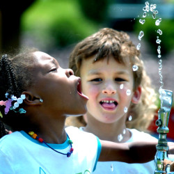 Tianna Swisher tries to drink from the water fountain at Montour Preserve near Washingtonville, Pa. Fluoride in drinking water, credited with dramatically cutting cavities and tooth decay, has been tied to white splotches on children's teeth.