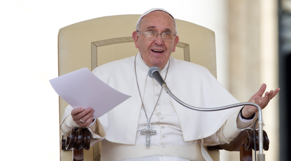 Pope Francis delivers his message during the weekly general audience in St. Peter's Square at the Vatican, Wednesday.