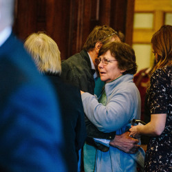 "Kathleen Kelley, wife of Leon Kelley, and William Kelley, brother of the victim, hug after Merrill ""Mike"" Kimball is found guilty of Leon Kelley's murder on April 15. Kathleen Kelley is seeking $1 million from Kimball in a wrongful-death lawsuit."