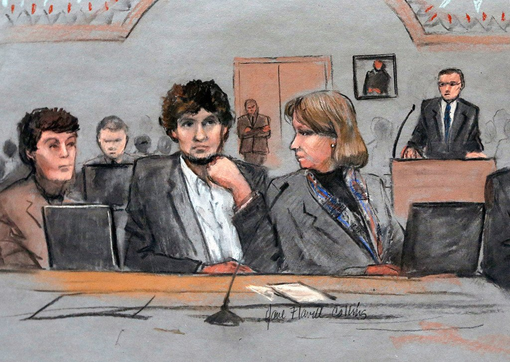 Dzhokhar Tsarnaev, center, is depicted in a courtroom sketch between defense attorneys Miriam Conrad, left, and Judy Clarke, right, during his federal death penalty trial in Boston. He was found guilty on all 30 counts.