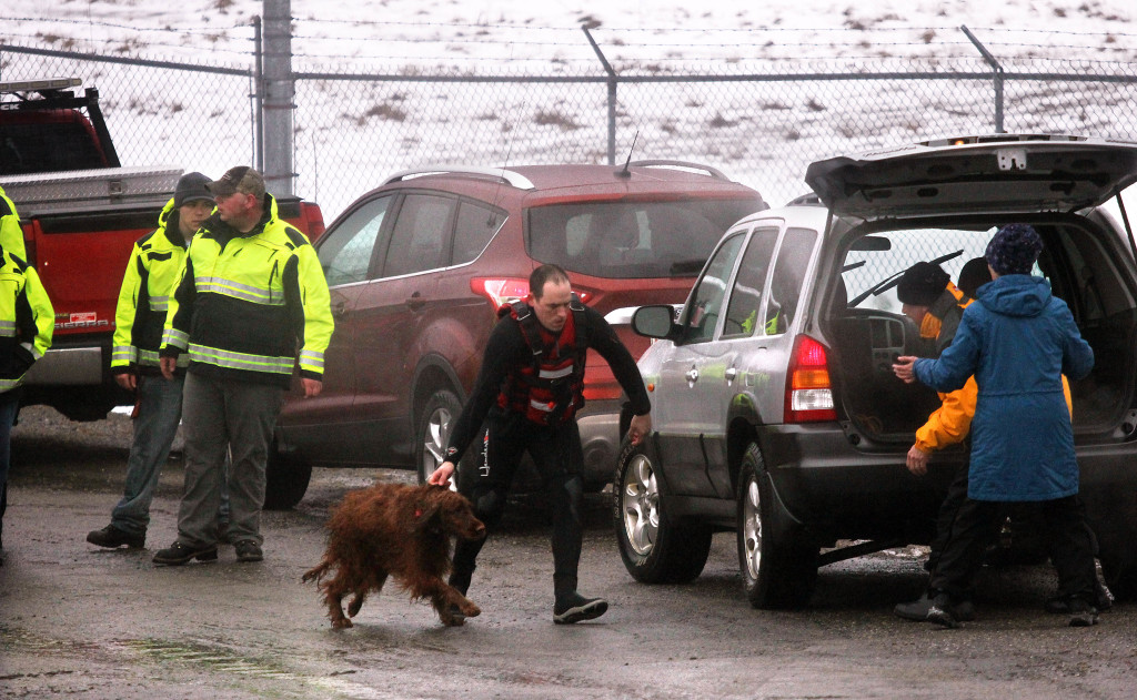 An Irish Setter is delivered to its owners shortly after being rescued from the icy waters of the Kennebec River in Winslow on Friday.