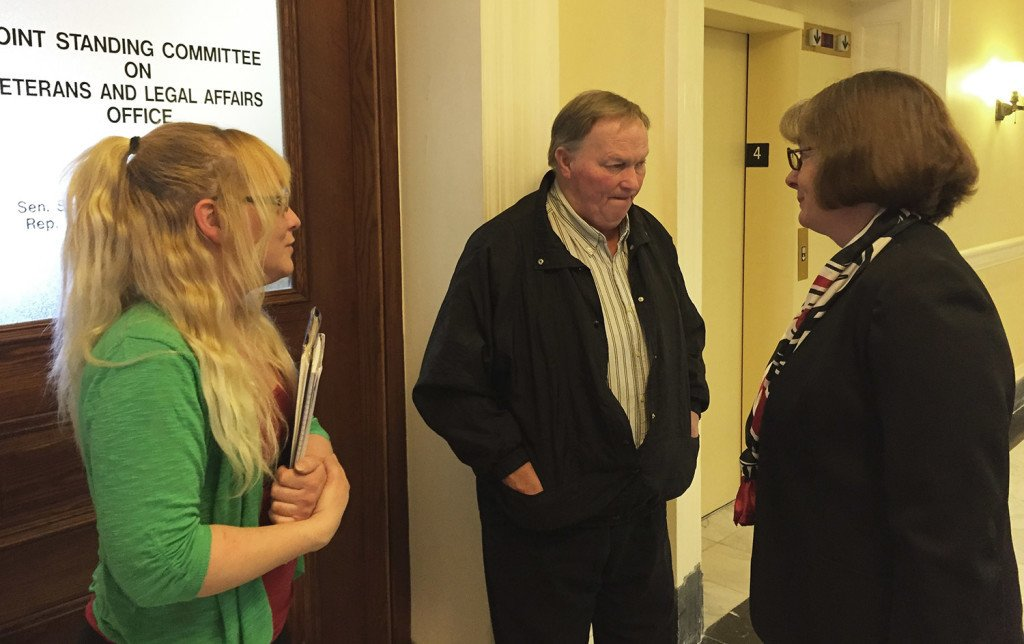 Jenny McPherson, left, and her father, Craig McPherson Sr., speak with Rep. Stacey Guerin about a bill to criminalize driving while extremely tired. Craig McPherson Jr. died in a car crash in Windham March 9, 2014, when his car collided with a car driven by someone who was allegedly fatigued. David Hench/Staff Photographer
