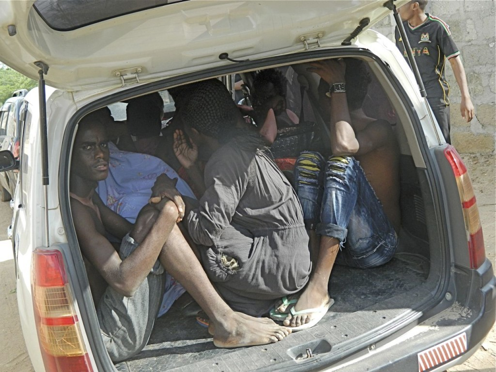 Garissa University College students take cover in the back of a truck after escaping from gunmen who attacked the campus early Thursday, shooting indiscriminately. The Associated Press