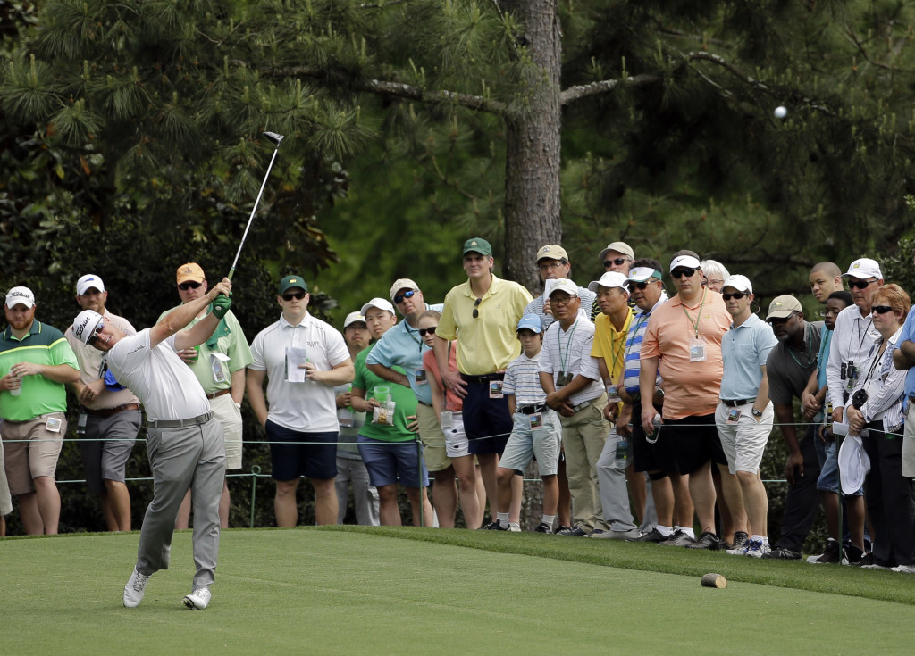 Charley Hoffman tees off on the 15th hole during the second round of the Masters golf tournament Friday. Hoffman made three birdies on the back nine as he tried to keep pace with Jordan Spieth. He finished with a 68, five shots behind.