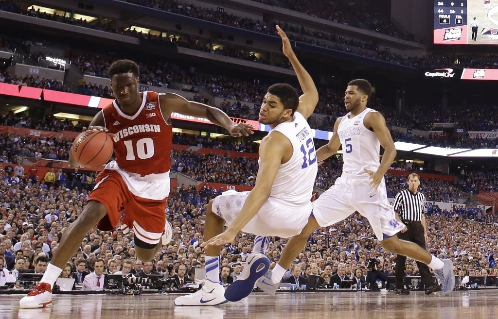 Wisconsin's Nigel Hayes (10) drives against Kentucky's Karl-Anthony Towns during the second half of the NCAA Final Four semifinal game Saturday in Indianapolis. The Associated Press