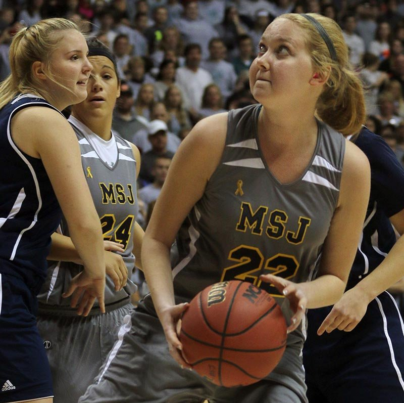 Mount St. Joseph's Lauren Hill catches a pass and prepares to shoot during her first NCAA college basketball game in November 2014.