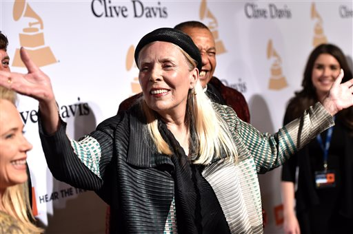 Joni Mitchell, seen at the 2015 Clive Davis Pre-Grammy Gala on Feb. 7, was hospitalized Tuesday, according to her Twitter account and website. Associated Press file photo by John Shearer/Invision
