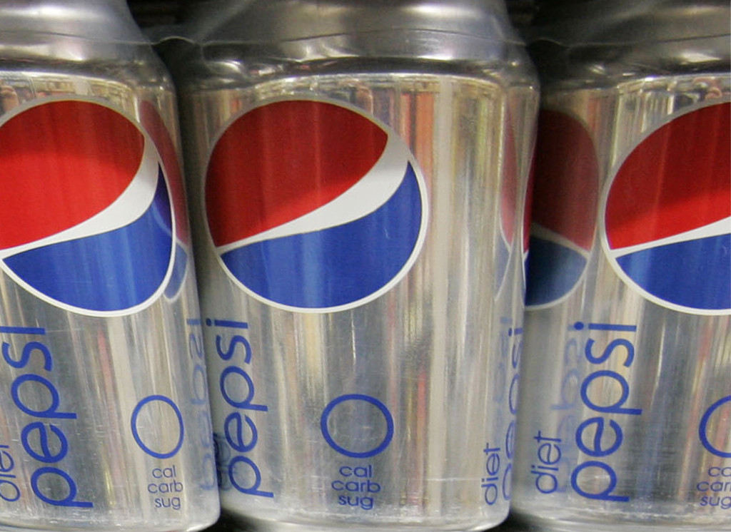 Diet Pepsi drinks on display at a market  in Palo Alto, Calif.  The decision to swap sweeteners comes as Americans keep turning away from popular diet sodas. Coca-Cola said this week that sales for Diet Coke fell 5 percent in North America in the first three months of the year. The Associated Press
