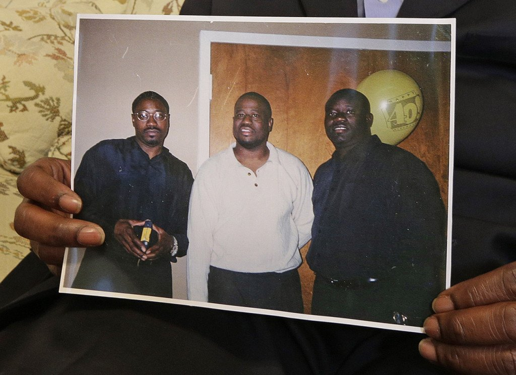 The Scott brothers in a family photo: shooting victim Walter is on the  left; Anthony is in the  center, and Rodney is at right. The Associated Press