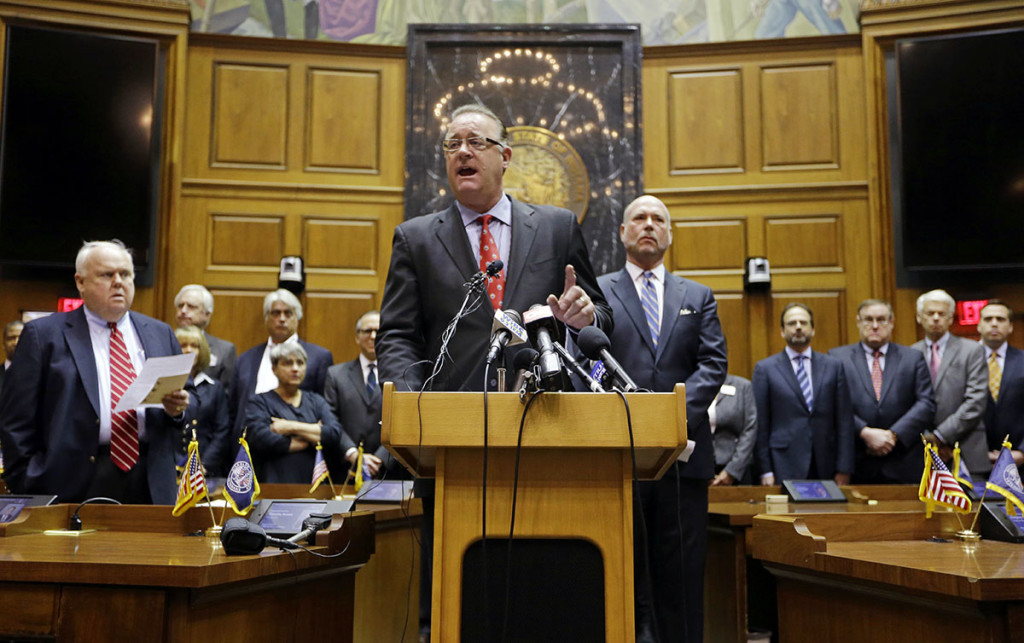 """Indiana Senate President Pro Tem David Long, left, R-Fort Wayne, and House Speaker Brian C. Bosma, R-Indianapolis, are joined by business leaders as they announce proposed changes to the state's new """"religious objections"""" law at the Statehouse in Indianapolis Thursday. The Associated Press"""