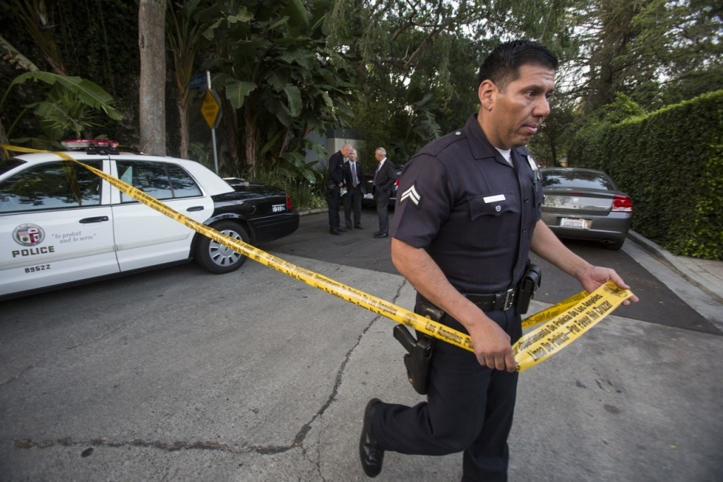 A police officer creates a perimeter outside the home of Andrew Getty in the Hollywood Hills area of Los Angeles Tuesday.