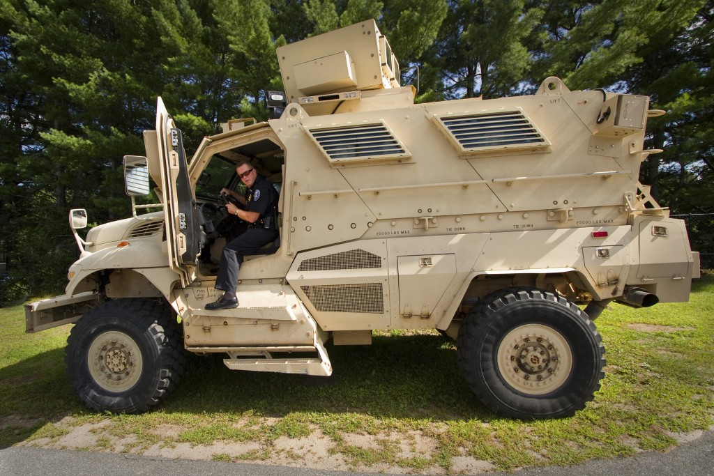 Sanford Police Chief Thomas Connolly steps down from the department's Mine-Resistant Ambush Protected vehicle last summer. A new executive order from the Obama administration reins in the use of such military equipment by local police departments.  Press Herald file photo