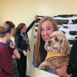 Volunteers with the Mount Merici Young Alums decorate the Waterville Area Humane Society in December in memory of Cassidy Charette, of Oakland, whose picture was also hung. Charette died in a Halloween hayride accident last fall, and that case goes to an Androscoggin County grand jury next week.
