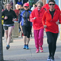Runners and walkers head north Friday on Water Street toward the Kennebec River Rail Trail from Kennebec Valley Coaching in Augusta. The Miles for Mom fundraiser donated $1,200 to the Harold Alfond Center for Cancer Care in Augusta.