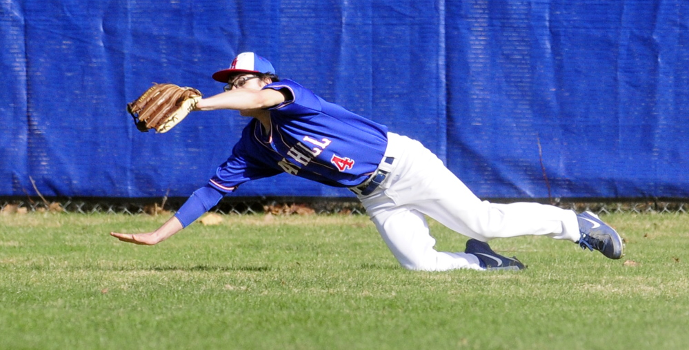 Oak Hill left fielder Kaleb Morrisette makes a diving catch during a game against Dirigo on Friday in Wales.
