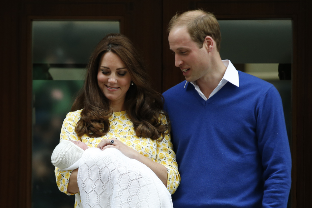 Britain's Prince William, right, and Kate, Duchess of Cambridge, with their newborn daughter pose for the media outside St. Mary's Hospital's exclusive Lindo Wing, London, on Saturday. The Duchess gave birth to the Princess on Saturday morning.