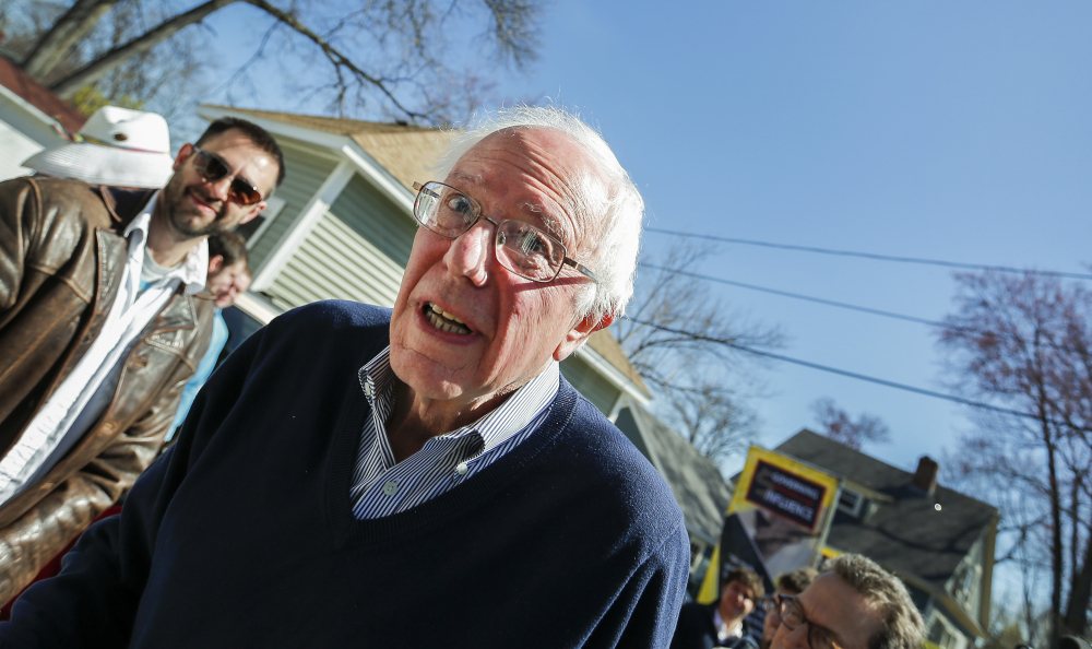 Presidential hopeful Sen. Bernie Sanders makes his way in to a house party in Manchester, N.H., on Saturday.