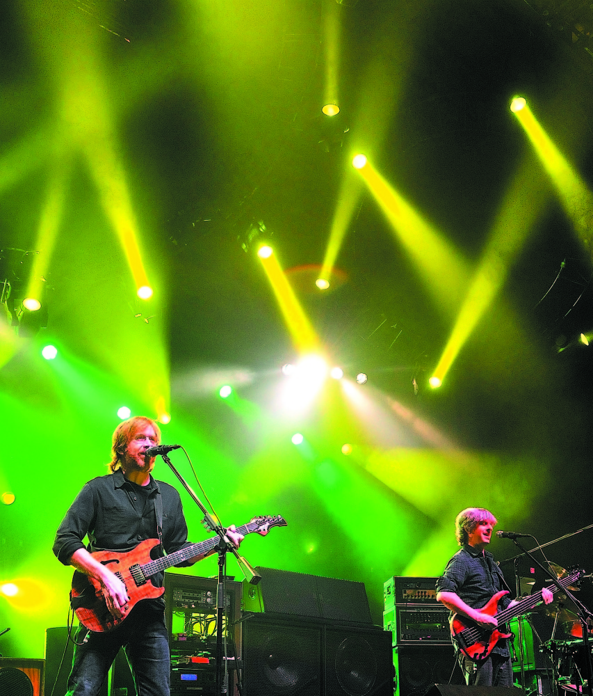 Trey Anastasio on guitar, left, and Mike Gordon on bass play in 2010 during a Phish concert at the Augusta Civic Center. In recent years, the civic center has had trouble bringing big concerts to the city.